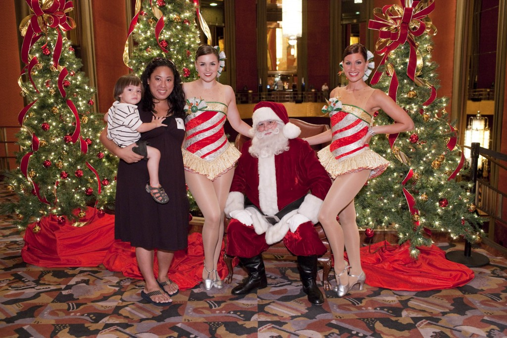 Jack and I with Santa and the Rockettes at the Mom Blogger Christmas Spectacular Party in August